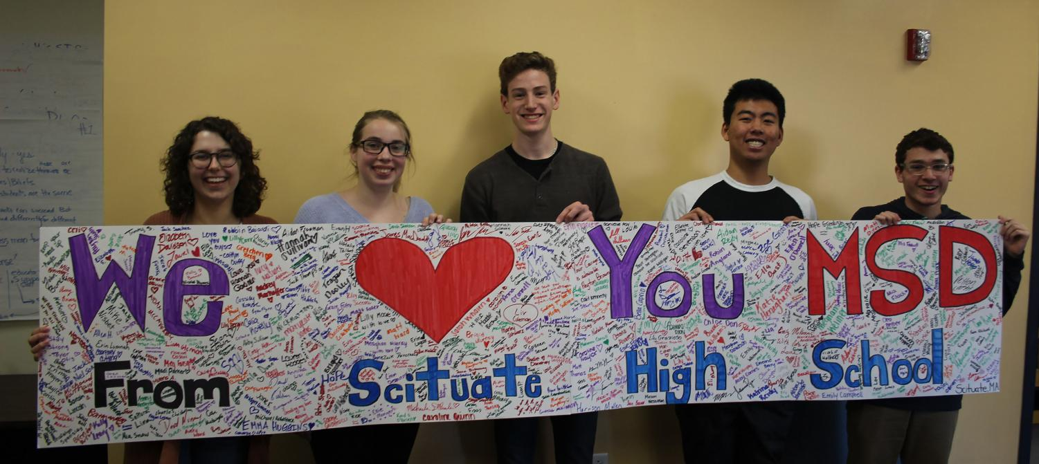 SHS Students (from left to right) Abby Hilditch, Emily Whitman, Birch Swart, Youta Adachi and Ryan Frankel hold the banner they made for SHS students to sign in support of the tragedy in Parkland, FL. Photo Courtesy of Lauren Montgomery