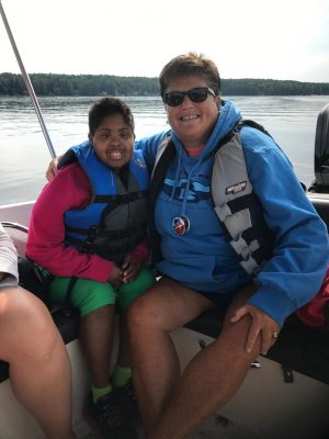 Kim Woodford enjoys a boat ride with one of her favorite campers