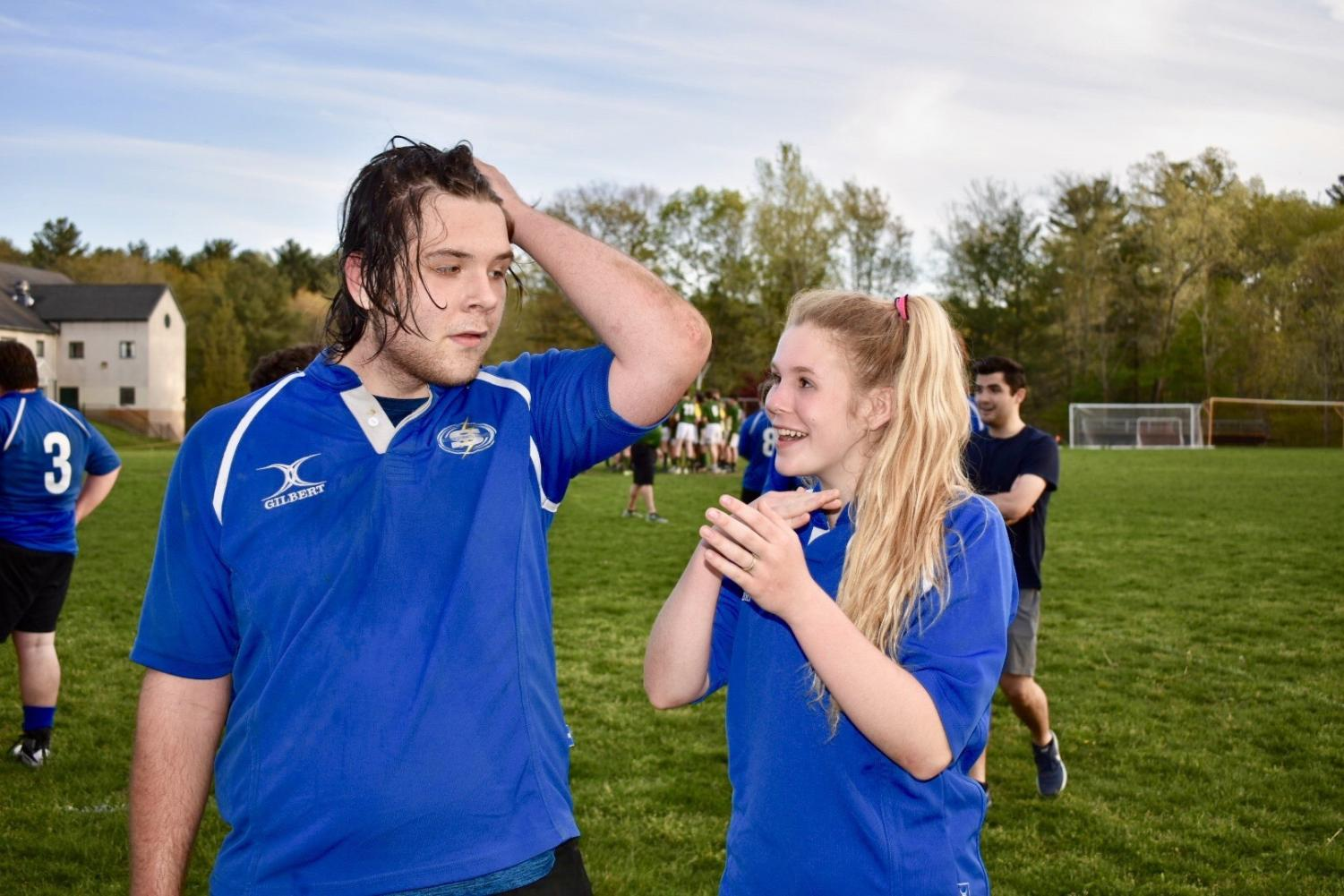 Sophomore Anja Soltesz on the rugby field with her brother