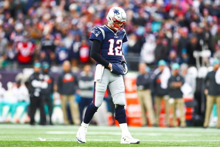 FOXBOROUGH%2C+MA+-+DECEMBER+29%3A+++Tom+Brady+%2312+of+the+New+England+Patriots+looks+on+during+a+game+against+the+Miami+Dolphins+at+Gillette+Stadium+on+December+29%2C+2019+in+Foxborough%2C+Massachusetts.++%28Photo+by+Adam+Glanzman%2FGetty+Images%29