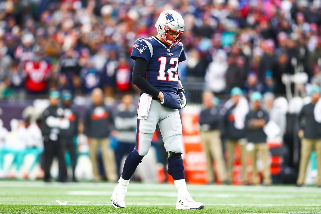 FOXBOROUGH, MA - DECEMBER 29:   Tom Brady #12 of the New England Patriots looks on during a game against the Miami Dolphins at Gillette Stadium on December 29, 2019 in Foxborough, Massachusetts.  (Photo by Adam Glanzman/Getty Images)