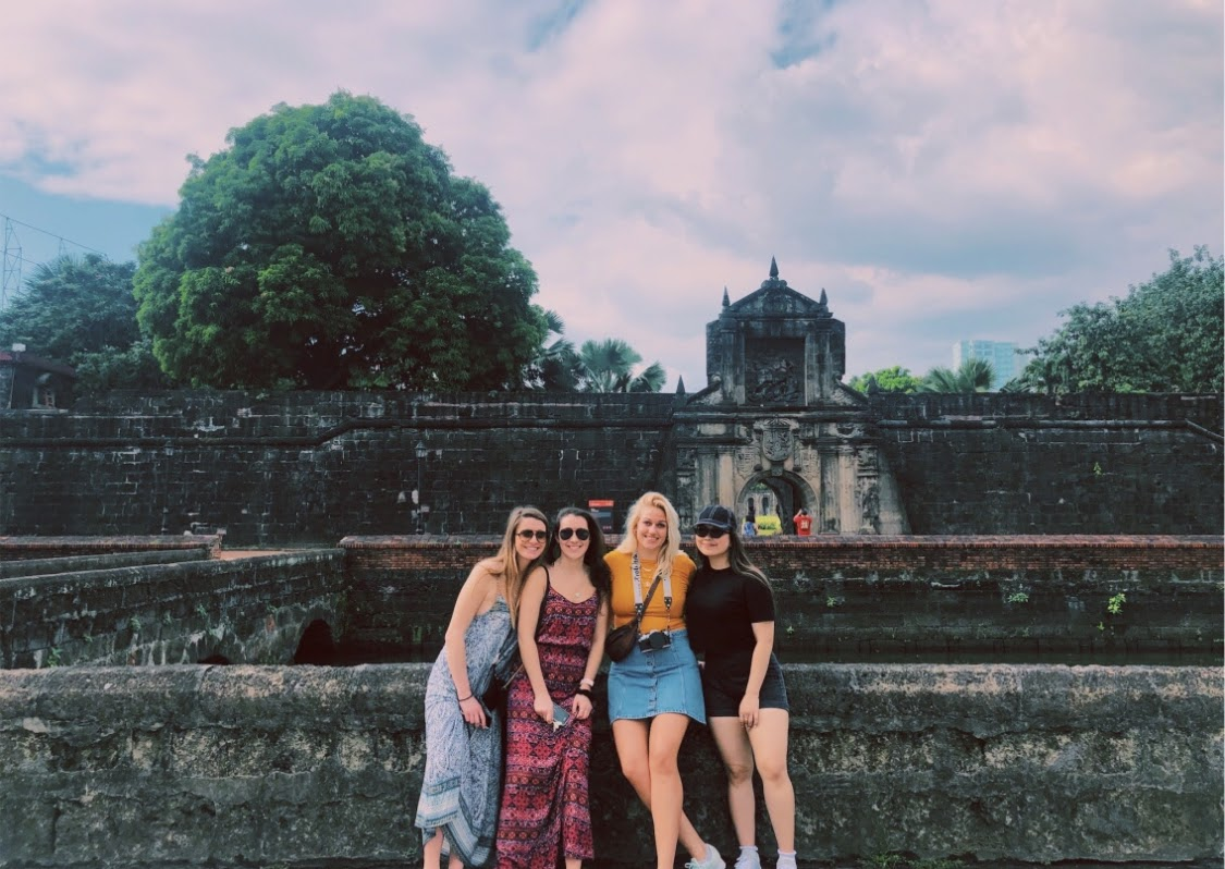 SHS alum Julia Cuneo (far left) is spending a semester in the Philippines
