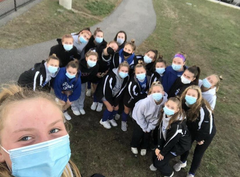 Varsity field hockey captain Sarah Irish takes a selfie with her teammates.