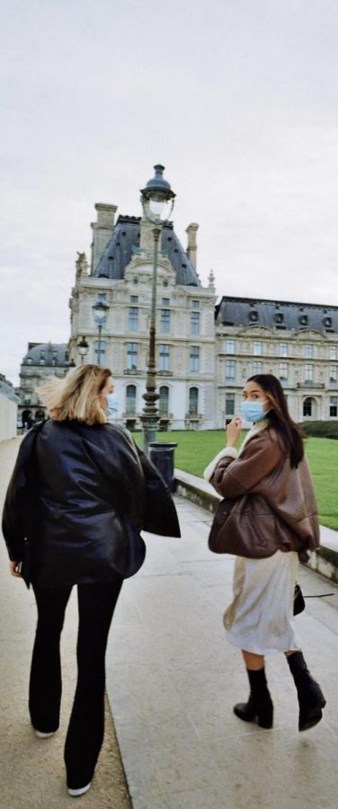 The global pandemic is not preventing Pia Bertola (right) from enjoying college life in Paris, France
