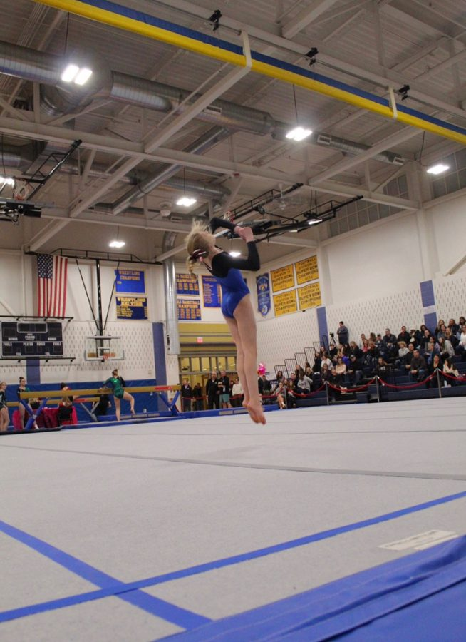 Sophomore Lucy Finkle performs her floor routine during a gynmastics meet last winter